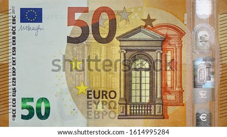 Fragment part of 50 euro banknote close-up with small brown details Royalty-Free Stock Photo #1614995284