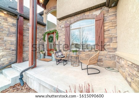 Exterior patio with two wicker comfy chairs #1615090600