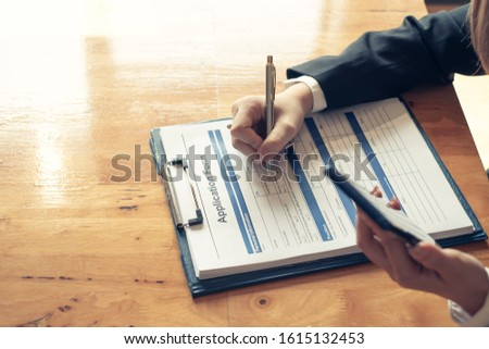 Close up. Hand Woman who are filling application form. #1615132453