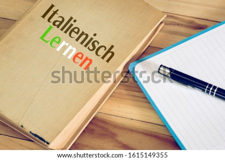 Book, notebook and German translation for learning Italian #1615149355