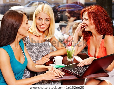 Two women at laptop drinking cocktail in a cafe. #161526620