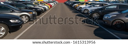 Cars in a rows. Used car sales Royalty-Free Stock Photo #1615313956