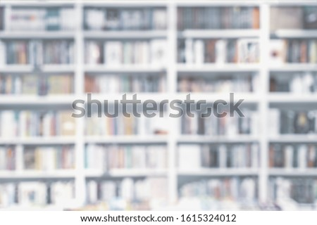 Abstract blurred bookshelves with books, manuals and textbooks on bookshelves in library or in book store, soft focus. Concept of learning, school, culture, education, for backdrop #1615324012