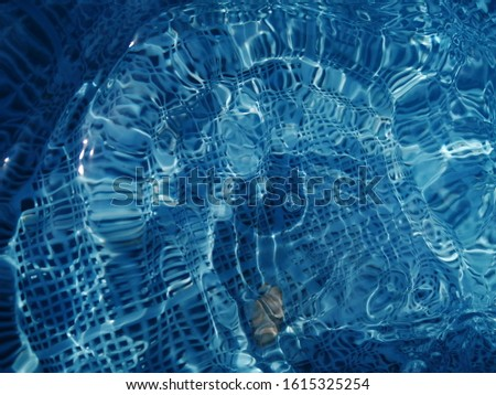 Deep blue water texture reflected by sunlight. Sunlight effected to surface blue water. Blue water use for background #1615325254