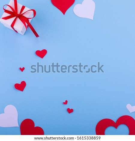 Valentine's day abstract background with paper cut red hearts decoration, flat layout, empty space for text #1615338859