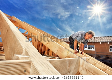 Carpenters Setting up a Half-timbered Building and the Timber Ro #1615339942