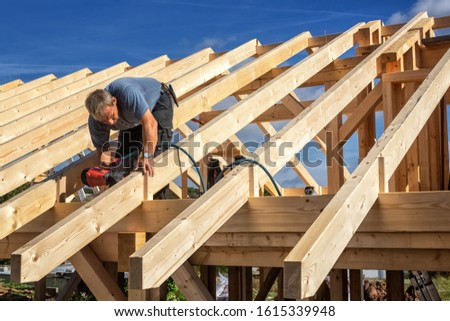 Carpenters Setting up a Half-timbered Building and the Timber Ro #1615339948
