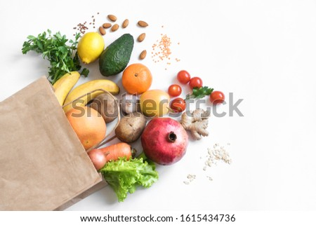Healthy food background. Healthy vegan vegetarian food in paper bag vegetables and fruits on white, copy space. Shopping food supermarket and clean vegan eating concept. #1615434736