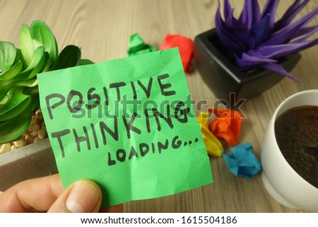 Slogan positive thinking loading handwritten on sticky note, success and motivation concept #1615504186