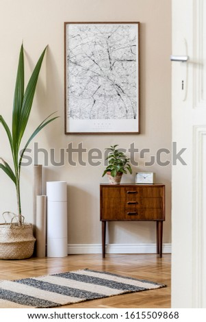 Modern composition of living room interior with brown mock up poster frame, design retro commode, rattan basket with tropical plant and elegant accessories. Template. Stylish home staging. Japandi.