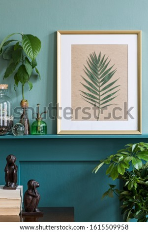 Interior design of living room with gold mock up photo frame on the green shelf with beautiful plants in different hipster and design pots. Elegant personal accessories. Home gardening. Template.