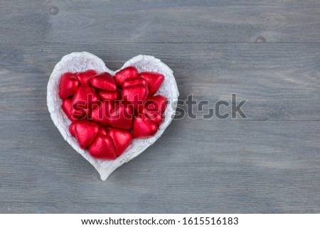 heart-shaped sweets in a vase in the shape of angel wings #1615516183