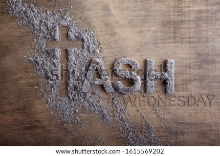 Ash wednesday word written in ash and christian cross symbol as a religion concept Royalty-Free Stock Photo #1615569202