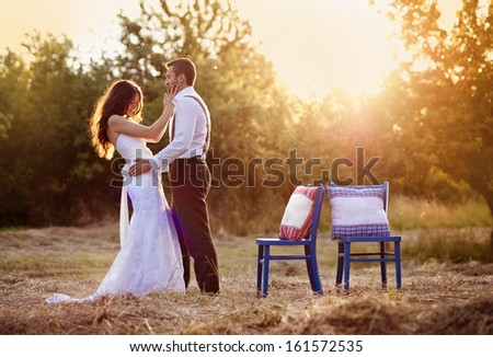 Beautiful bride and groom portrait in nature #161572535
