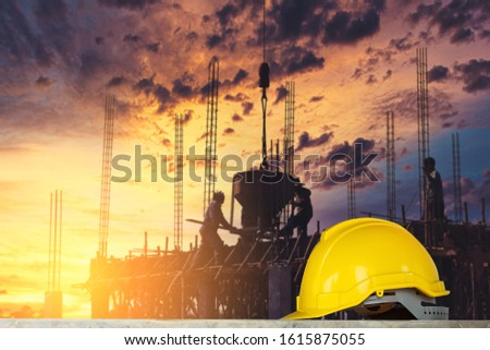 yellow helmet in construction site and construction site worker background safety first concept #1615875055