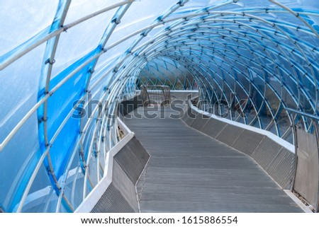 Modern structural glass curving roof and the wooden pathway at Anyang art public park in South, Korea #1615886554