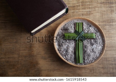 Ash wednesday, crucifix made of ash, dust as christian religion. Lent beginning Royalty-Free Stock Photo #1615918543