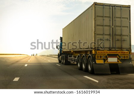 Cargo Truck on highway road with container, transportation concept.,import,export logistic industrial Transporting Land transport on the expressway against sunrise sky #1616019934