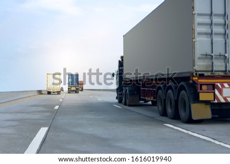 Truck on highway road with container, transportation concept.,import,export logistic industrial Transporting Land transport on the asphalt expressway against blue sky #1616019940