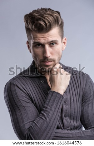 portrait of a handsome guy in a black sweater #1616044576