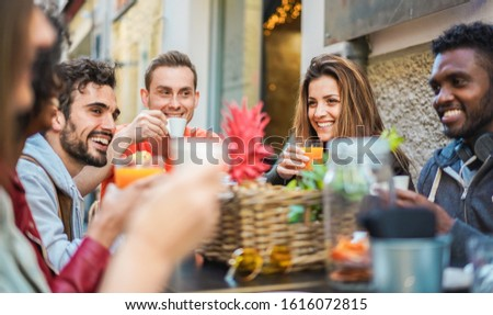 Group of happy friends drinking coffee and cappuccino at vintage bar outdoor - Young millennials people doing breakfast together - Friendship, youth and food concept - Focus on right girl face #1616072815