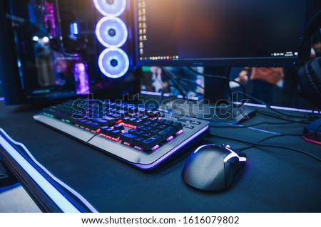 The abstract image of the gamer's desk consisting of the desktop computer and gaming gear. the concept of activities, gaming, technology, lifestyle, education, e-sport and internet of things. #1616079802
