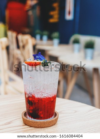 Strawberry, mixed with raspberry soda(italian sodas) and fresh strawberry meat. On the top, the background is a coffee shop. #1616084404
