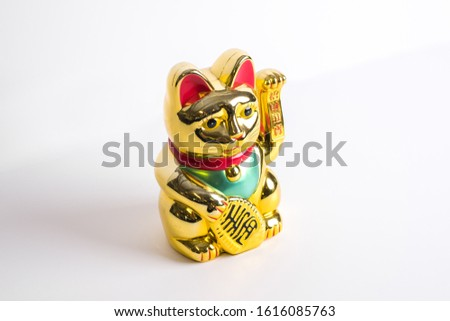 Gold lucky cat with waving hand from Hong Kong for good luck and good fortune #1616085763