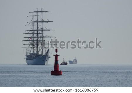 NAVIGATION BUOY - Sailing vessel, maerchant vessel and motorboat at the sign  #1616086759