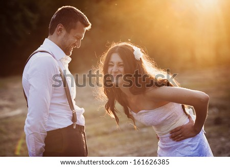 Beautiful bride and groom portrait in nature #161626385