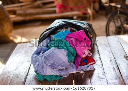Old heaps of cloth that are hard to degrade according to natural processes. But can be recycled #1616289817
