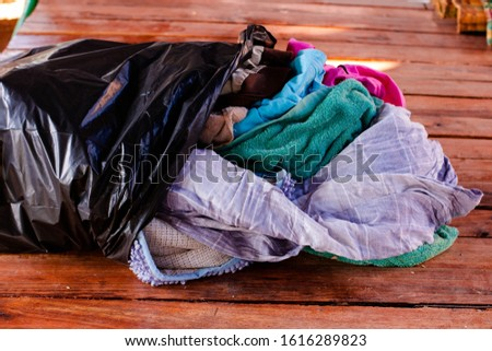 Old heaps of cloth that are hard to degrade according to natural processes. But can be recycled #1616289823
