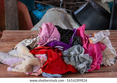 Old heaps of cloth that are hard to degrade according to natural processes. But can be recycled #1616289826
