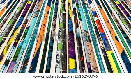 Stack of old comic books creates colorful paper background texture
