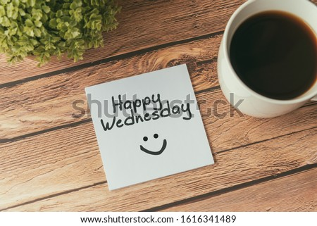 Happy Wednesday with smile greeting on paper note with cup of coffee Royalty-Free Stock Photo #1616341489