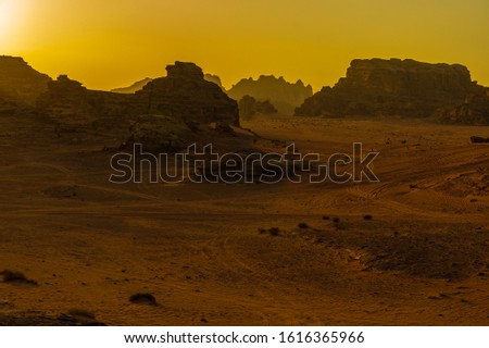 Vintage photos from archive. Jordan. Sunset in Wadi Rum desert. Martian landscapes in lifeless desert. Red rocks and red sand.  #1616365966