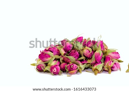 Dried rose buds for herbal tea isolated on white background