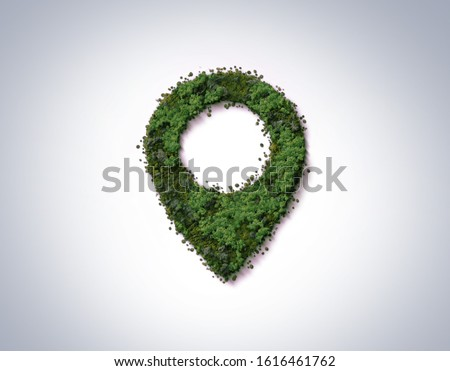 Green location symbol of pin. A green forest shape on location pin concept of green place for tourist or visit. Green Destination. Environment day concept. World Forestry Day. Royalty-Free Stock Photo #1616461762