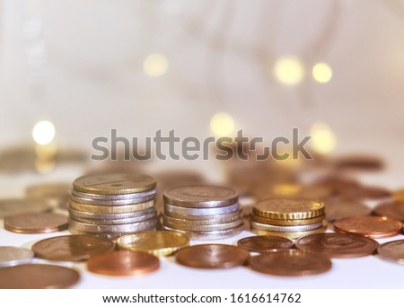 Coins stacked in stacks on a colored background with a side #1616614762