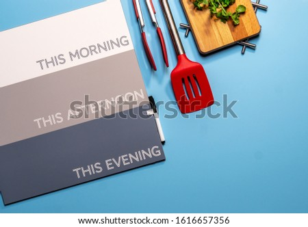 Flat lay of proactive meal workspace with cutting board planning to get healthy #1616657356