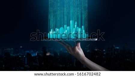 5G network wireless systems,IoT(Internet of Things),communication network concept.Human hand holding an empty digital tablet with smart city and 5G network wireless systems and internet of things. #1616702482