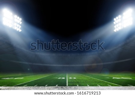 American football stadium with bright lights