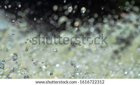 Water backgrounds with foam spray fast flow. The water in mad flows with droplets and whirlpools of waterfalls. #1616722312