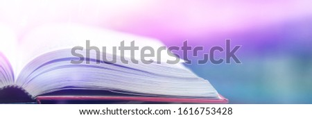 Book stack in the library and blurred bookshelf background for education. education background. back to school  concept. #1616753428
