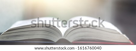 Book stack in the library and blurred bookshelf background for education. education background. back to school  concept. #1616760040