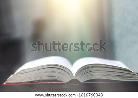 Book stack in the library and blurred bookshelf background for education. education background. back to school  concept. #1616760043