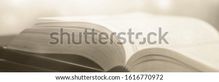 Book stack in the library and blurred bookshelf background for education. education background. back to school  concept. #1616770972