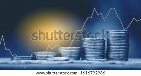 Double exposure of money coin, stock market or forex trading graph and candlestick chart suitable for financial investment concept.  #1616792986
