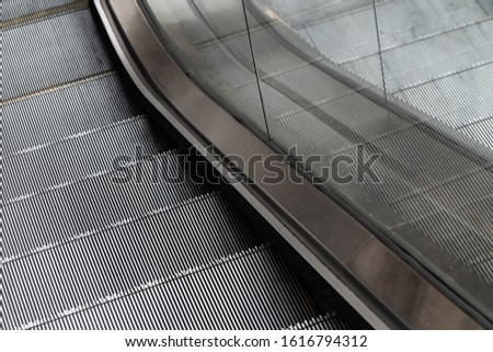 Close up at escalator's part as geometric detail - street photo, selective focus at the step's plate. #1616794312