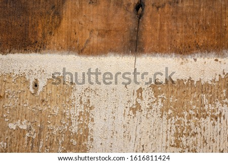background texture of weathered barn wood with grain and white paint peeling off #1616811424